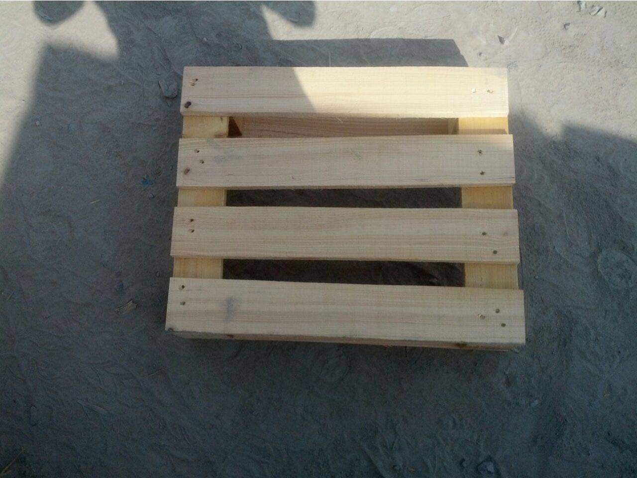wooden pallet on the floor in shade